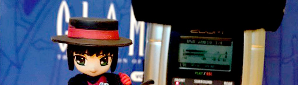 A photo of a figurine of Subaru from CLAMP's Tokyo Babylon, with a recording mic in the background. Overlay text lists the name of the episode.